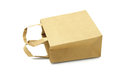 Brown paper bag recycled lying on white background Stock Photo