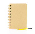 Brown paper notebook with yellow pencil isolated on white backgr Royalty Free Stock Photo