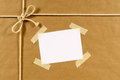 Brown paper package background, address label, sticky tape Royalty Free Stock Photo