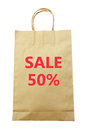 Brown paper shopping bag with Sale 50 % text isolated on white background (clipping path) Royalty Free Stock Photo
