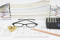 Brown pencil with black spectacles and gold coins Royalty Free Stock Photo
