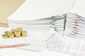 Brown pencil and gold coins with house on finance account Royalty Free Stock Photo