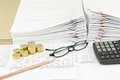 Brown pencil and gold coins with spectacles and calculator Royalty Free Stock Photo