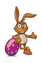 Brown rabbit leaning on purple egg a cartoon character a large easter Stock Photo