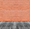 Brown red brick wall and black wooden floor background Stock Photos