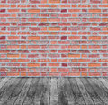 Brown red brick wall and black wooden floor background Stock Photo
