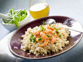 Brown rice with shrimp and arugula Royalty Free Stock Image