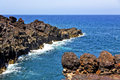 Brown rock in white coast lanzarote spain beach stone water and summer Stock Photos