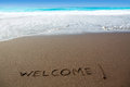 Brown sand beach with written word Welcome Stock Photo