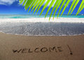 Brown sand beach with written word Welcome Royalty Free Stock Photo
