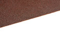 Brown sandpaper texture, closeup shot Royalty Free Stock Photo