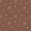 Brown seamless background with beige flowers and white dots. Cute floral pattern. Vector
