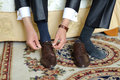 Brown shoes groom tying strings of Royalty Free Stock Photography
