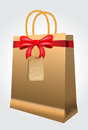 Brown shopping bag with paper handles and red bow on white background Royalty Free Stock Images