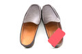 Brown slip on casual shoes over a white background Stock Photos