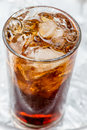 Brown soda a glass of with ice cubes Royalty Free Stock Photo