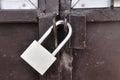 Brown steel door with padlock, Locked. Royalty Free Stock Photo