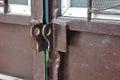 Brown steel door without padlock, unlocked. Royalty Free Stock Photo
