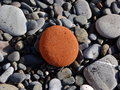 Brown stone among stones Royalty Free Stock Photo