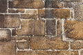 Brown stone wall old blocks for background or texture Royalty Free Stock Photo
