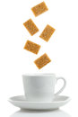 Brown sugar cubes with coffee cup Stock Photography