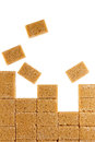 Brown sugar cubes on white background Royalty Free Stock Photography