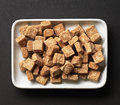 Brown sugar cubes in a white bowl Royalty Free Stock Photos