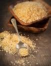 Brown sugar demerara sugar on wooden background Royalty Free Stock Photos