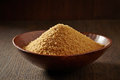 Brown sugar in a wooden bowl Royalty Free Stock Photo