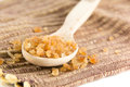 Brown sugar in wooden spoon Royalty Free Stock Photos