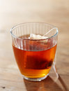 Brown tea on glass cup wooden table Royalty Free Stock Images