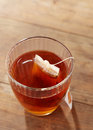 Brown tea on glass cup wooden table Royalty Free Stock Image