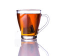Brown tea and tea bag single cup of in glass cup with isolated on white background Royalty Free Stock Photo
