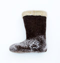 Brown valenki russian felt footwear on a snow Royalty Free Stock Image