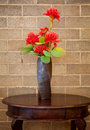 Brown vase and flower Stock Photography