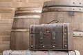 Brown vintage bag with wooden barrel background leather Stock Photography