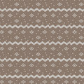 Brown and white curved striped with diamond shape and dot knitti