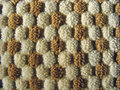 Brown and white relief plush fabric texture Stock Images