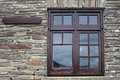 Brown window frame on a brick wall still ife Royalty Free Stock Photos