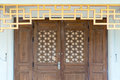Brown wood door with vintage chinese style Royalty Free Stock Photo