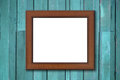 Brown wood picture frame on Green wall Royalty Free Stock Images