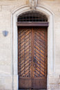 Brown wooden door old relief Royalty Free Stock Photo