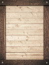 Brown wooden frame screwed on light wall planks Royalty Free Stock Photo