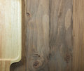 Brown wooden plate on pine plank Royalty Free Stock Photo