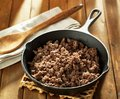 Browned ground beef in cast iron skillet Royalty Free Stock Photo