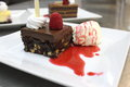 Brownie cake with raspberry sauce delicious Stock Photography