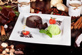Brownie cake with strawberries, tea, spices, pistachio ice cream, atmosphere Royalty Free Stock Photo