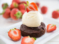 Brownie with  ice cream and strawberries Royalty Free Stock Photo