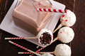 Brownie peppermint cake pops and glass milk carton filled with chocolate milk and colorful straw Royalty Free Stock Photos