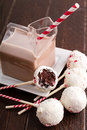Brownie peppermint cake pops and glass milk carton filled with chocolate milk and colorful straw Stock Photos